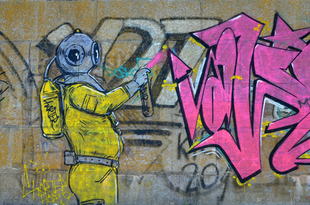 Fragment of graffiti drawings. The old wall decorated with paint stains in the style of street art culture. Scary scuba diver.