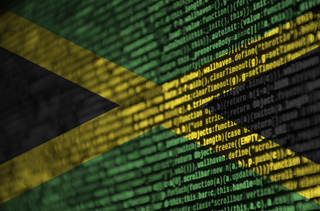 Jamaica flag  is depicted on the screen with the program code. The concept of modern technology and site development.
