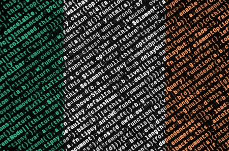 Ireland flag  is depicted on the screen with the program code. The concept of modern technology and site development.
