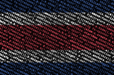 Costa Rica flag  is depicted on the screen with the program code. The concept of modern technology and site development.