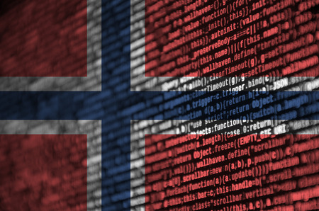 Norway flag  is depicted on the screen with the program code. The concept of modern technology and site development. Stock Photo