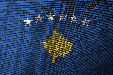 Kosovo flag  is depicted on the screen with the program code. The concept of modern technology and site development.