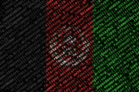 Afghanistan flag is depicted on the screen with the program code. The concept of modern technology and site development.