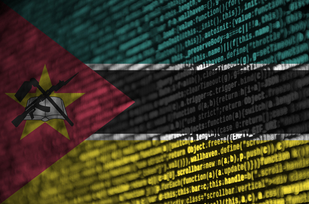 Mozambique flag  is depicted on the screen with the program code. The concept of modern technology and site development. Stock Photo