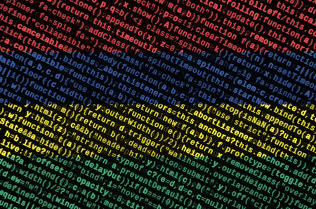 Mauritius flag  is depicted on the screen with the program code. The concept of modern technology and site development.
