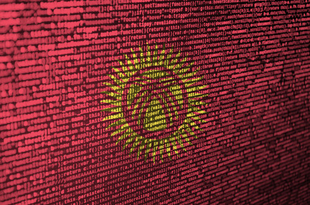 Kyrgyzstan flag  is depicted on the screen with the program code. The concept of modern technology and site development. Stock Photo