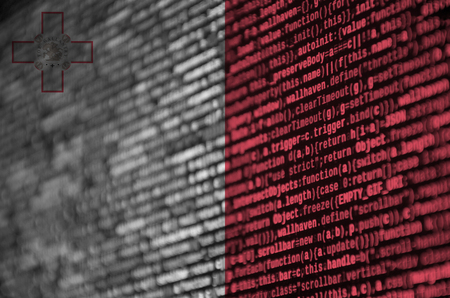 Malta flag  is depicted on the screen with the program code. The concept of modern technology and site development.