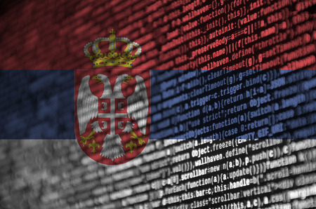 Serbia flag  is depicted on the screen with the program code. The concept of modern technology and site development.