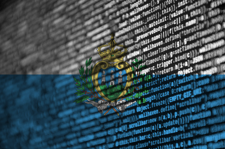 San Marino flag  is depicted on the screen with the program code. The concept of modern technology and site development.