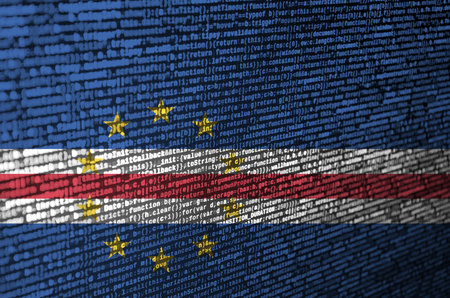 Cabo verde flag  is depicted on the screen with the program code. The concept of modern technology and site development.