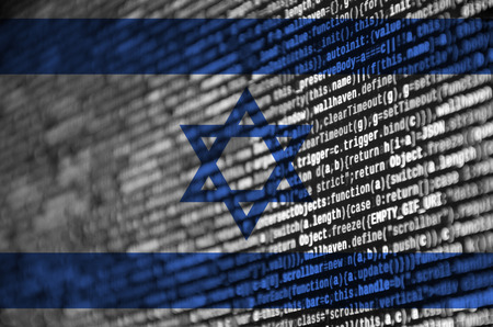 Israel flag  is depicted on the screen with the program code. The concept of modern technology and site development.