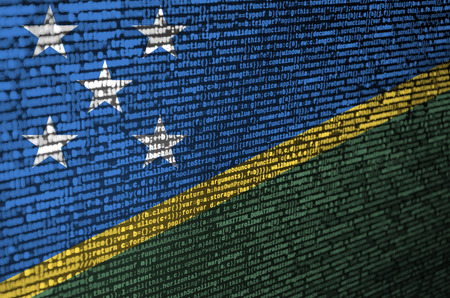 Solomon Islands flag  is depicted on the screen with the program code. The concept of modern technology and site development.