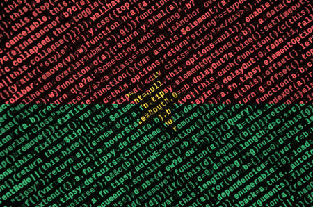 Burkina Faso flag  is depicted on the screen with the program code. The concept of modern technology and site development.