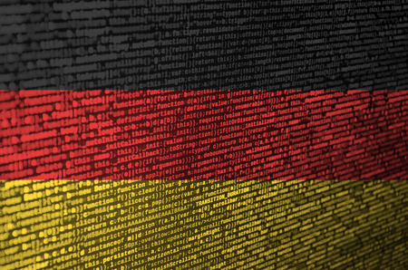 Germany flag  is depicted on the screen with the program code. The concept of modern technology and site development. Stock Photo