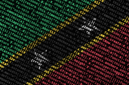 Saint Kitts and Nevis flag  is depicted on the screen with the program code. The concept of modern technology and site development.