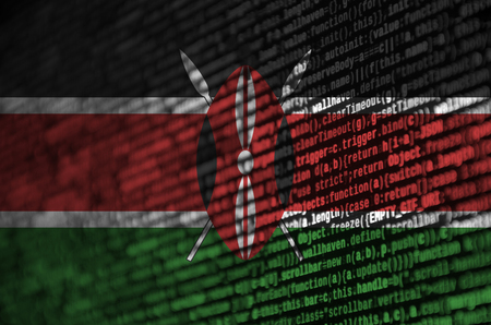 Kenya flag  is depicted on the screen with the program code. The concept of modern technology and site development.
