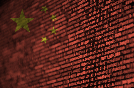 China flag  is depicted on the screen with the program code. The concept of modern technology and site development. Stock Photo