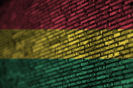 Bolivia flag  is depicted on the screen with the program code. The concept of modern technology and site development.
