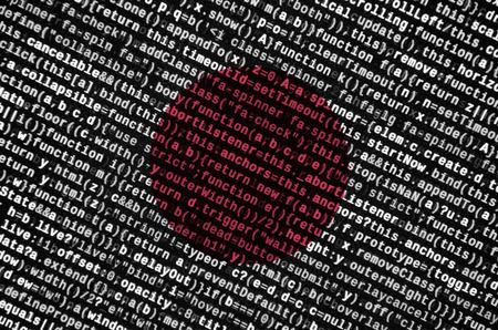 Japan flag  is depicted on the screen with the program code. The concept of modern technology and site development. Stock Photo
