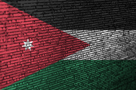 Jordan flag  is depicted on the screen with the program code. The concept of modern technology and site development. Stock Photo