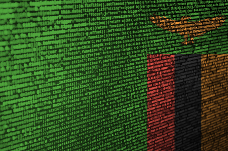 Zambia flag  is depicted on the screen with the program code. The concept of modern technology and site development.