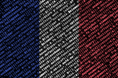 France flag  is depicted on the screen with the program code. The concept of modern technology and site development.