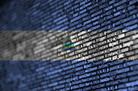 Nicaragua flag  is depicted on the screen with the program code. The concept of modern technology and site development.