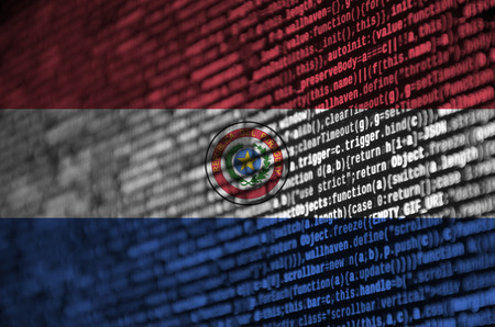 Paraguay flag  is depicted on the screen with the program code. The concept of modern technology and site development.