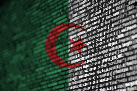 Algeria flag  is depicted on the screen with the program code. The concept of modern technology and site development. Stok Fotoğraf