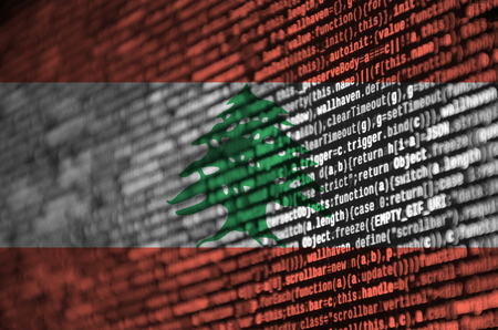 Lebanon flag  is depicted on the screen with the program code. The concept of modern technology and site development.
