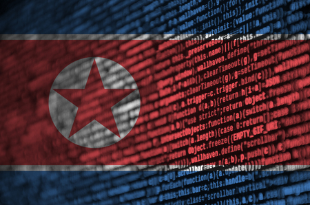 North Korea flag  is depicted on the screen with the program code. The concept of modern technology and site development. Zdjęcie Seryjne - 109442905