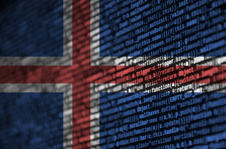 Iceland flag  is depicted on the screen with the program code. The concept of modern technology and site development.
