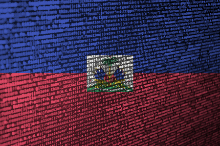 Haiti flag  is depicted on the screen with the program code. The concept of modern technology and site development.