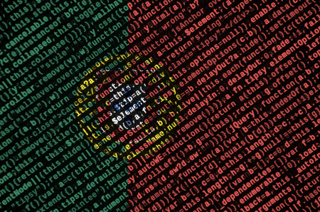 Portugal flag  is depicted on the screen with the program code. The concept of modern technology and site development.
