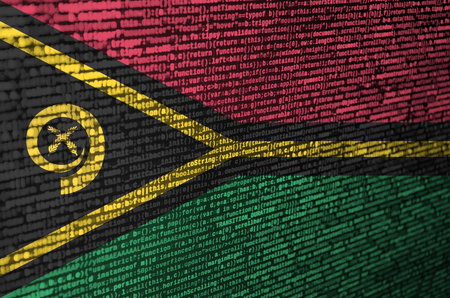 Vanuatu flag  is depicted on the screen with the program code. The concept of modern technology and site development.
