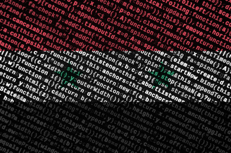 Syria flag  is depicted on the screen with the program code. The concept of modern technology and site development.