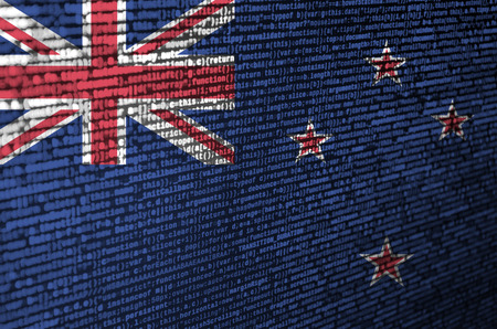 New Zealand flag  is depicted on the screen with the program code. The concept of modern technology and site development.
