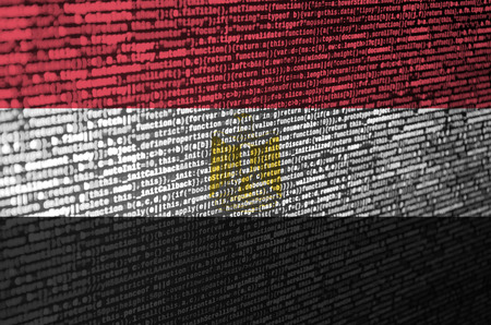Egypt flag  is depicted on the screen with the program code. The concept of modern technology and site development.