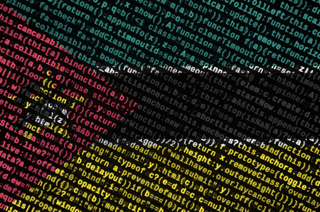 Mozambique flag  is depicted on the screen with the program code. The concept of modern technology and site development. Imagens - 109440761