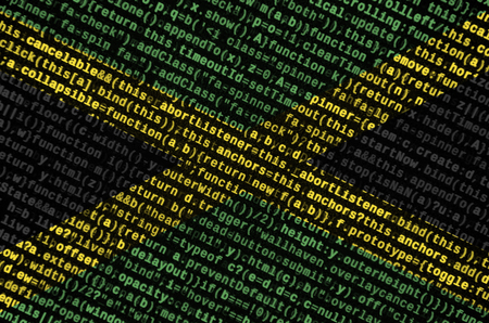 Jamaica flag  is depicted on the screen with the program code. The concept of modern technology and site development. Imagens - 109440772