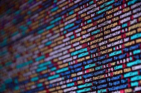 Software developer programming code on computer. Abstract computer script source code. Shallow depth of field, selective focus effect Stok Fotoğraf