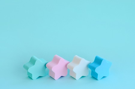 Abstract cosmetic light pastel blue background with small stars of sponges. Template with text space