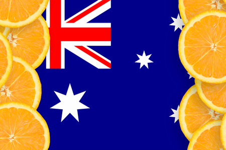 Australia flag  in vertical frame of orange citrus fruit slices. Concept of growing as well as import and export of citrus fruits