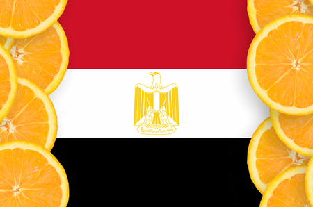 Egypt flag  in vertical frame of orange citrus fruit slices. Concept of growing as well as import and export of citrus fruits