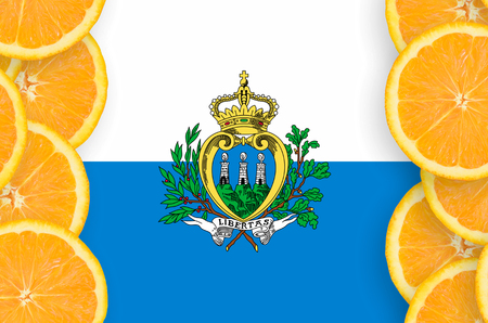 San Marino flag  in vertical frame of orange citrus fruit slices. Concept of growing as well as import and export of citrus fruits