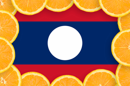 Laos flag  in frame of orange citrus fruit slices. Concept of growing as well as import and export of citrus fruits
