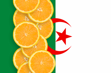 Algeria flag and vertical row of orange citrus fruit slices. Concept of growing as well as import and export of citrus fruits 版權商用圖片 - 114928602