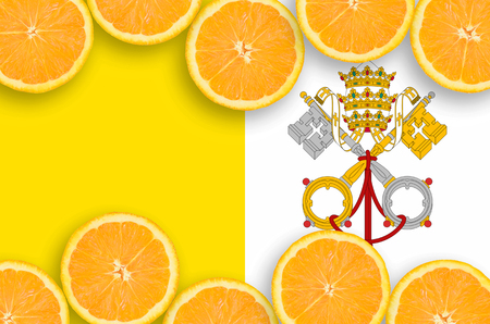 Vatican City State flag  in horizontal frame of orange citrus fruit slices. Concept of growing as well as import and export of citrus fruits