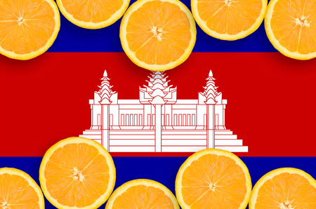 Cambodia flag  in horizontal frame of orange citrus fruit slices. Concept of growing as well as import and export of citrus fruits Reklamní fotografie