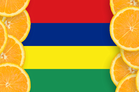 Mauritius flag  in vertical frame of orange citrus fruit slices. Concept of growing as well as import and export of citrus fruits